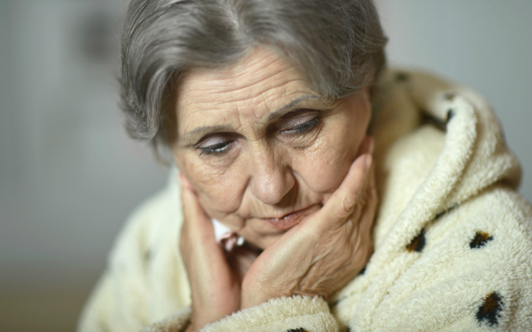 description_of-image_used_in_domestic_abuse_between_older_couples_sad_older_woman