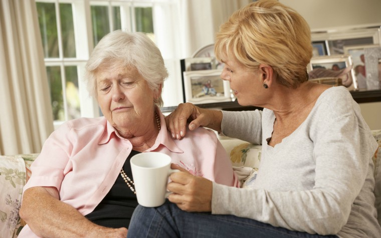 description_of_image_used_in_adult_attachment_podcast_daughter_comforting_elderly_mother_monkeybusinessimages_rex_shutterstock