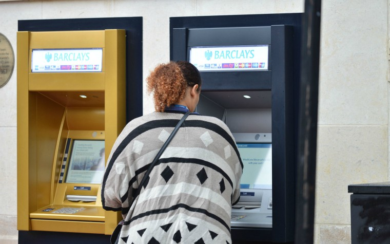 Description_of_image_used_in_direct_payments_quick_guide_to_the_lawwoman_at_cashpoint_Matthew_Chattle_rexfeatures_8881263c_760