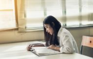 description_of_image_used_in_loneliness_research_review_student_reading_book_by_herself_fotolia_natara