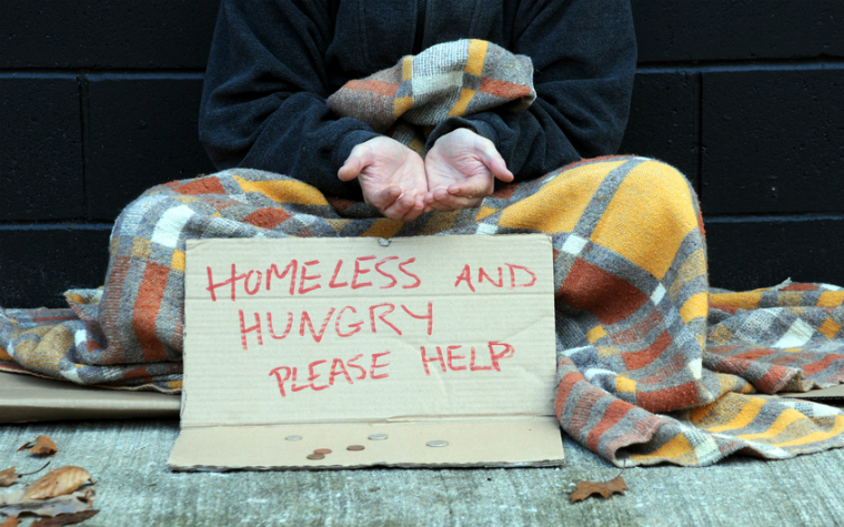 description_of_image_used_in_homelessness_guide_homeless_person_with_sign