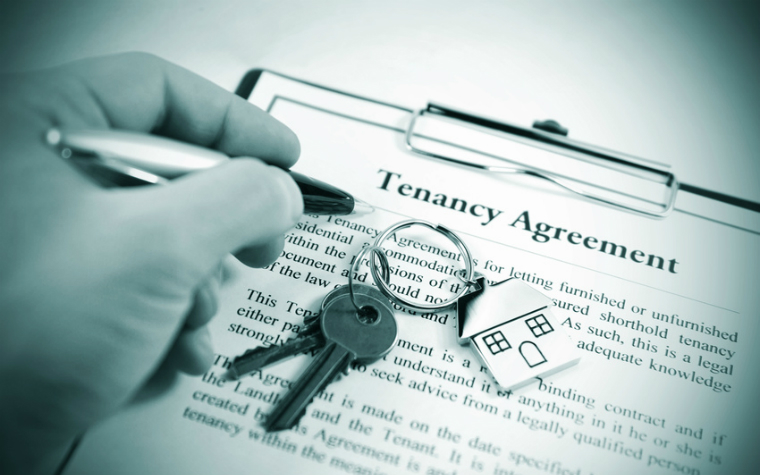 description_of_image_used_in_types_of_tenancy_guide_person_signing_a_tenancy_agreement