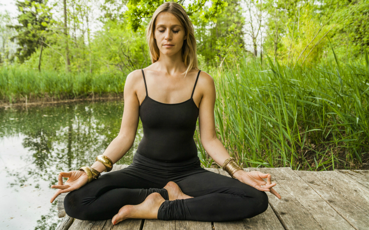 description_of_image_used_in_emotional_resilience_guide_woman_meditating