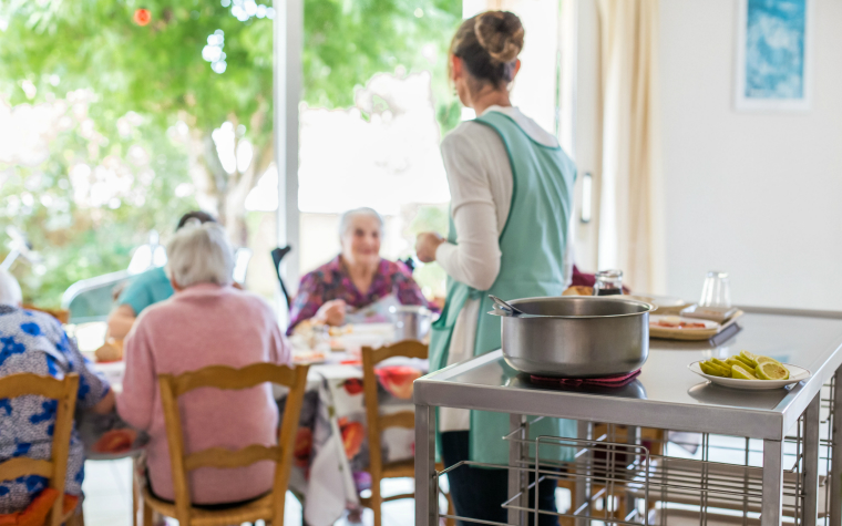 description_of_image_used_in_national_assistance_act_legislation_older_people_in_care_home_eating_meal_burger_phanie_rex_shutterstock
