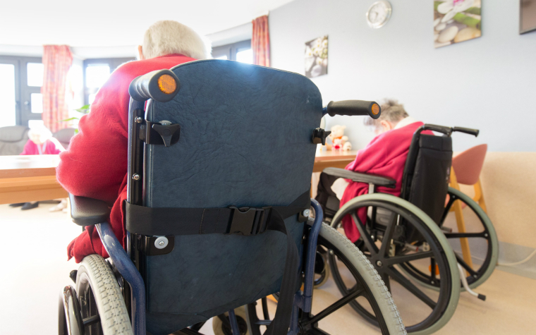 Description_of_image_used_in_health_and_social_care_act_legislation_wheelchair_users_in_nursing_home_Isopix_REX_Shutterstock