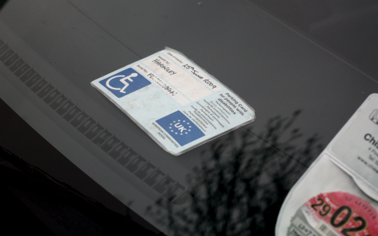 Description_of_image_used_in_disabled_persons_legislation_blue_badge_parked_car_JeffBlackler_REX_Shutterstock