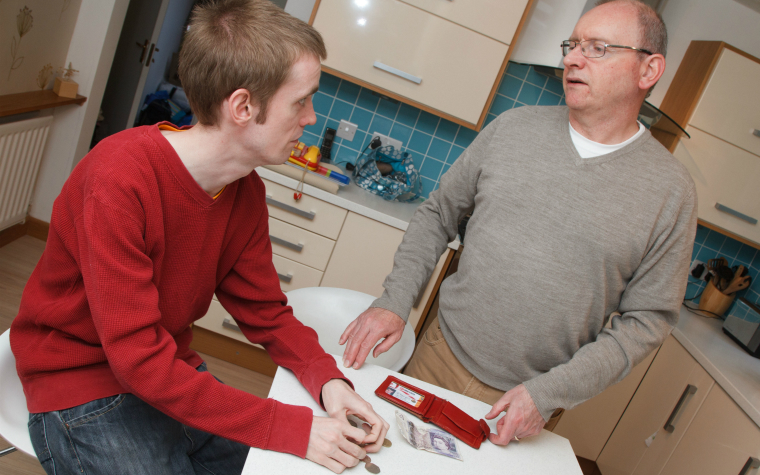 Description_of_image_used_in_autism_outside_resources_man_with_autism_talking_to_father_JohnBirdsall_REX_Shutterstock