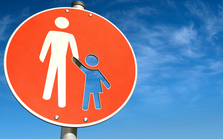description_of_image_used_in_parental_mental_capacity_case_law_traffic_sign_with_parent_and_child_bluedesign_fotolia