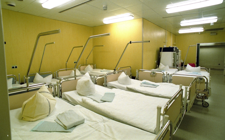 description_of_image_used_in_integration_good_practice_social_workers_empty_row_of_hospital_beds_imagebroker_rex_shutterstock