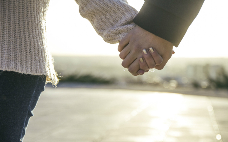description_of_image_used_in_adult_attachment_webinar_couple_holding_hands_westend61_rex_shutterstock