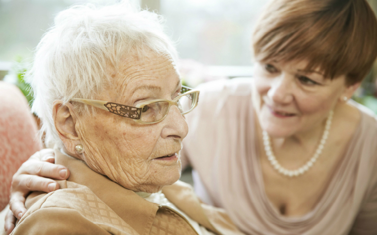 description_of_image_used_in_working_with_independent_advocates_younger_woman_comforting_older_woman_westend61_rex_shutterstock