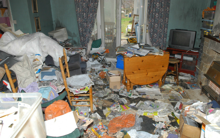 description_of_image_used_in_hoarding_webinar_living_room_covered_in_newspaper_west_yorkshire_fire_and_rescue_service
