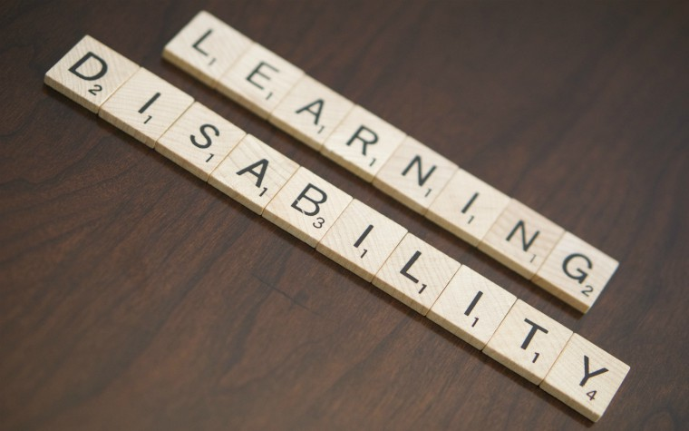 description_of_image_used_in_domestic_abuse_and_learning_disability_guide_learning_disability_on_scrabble_tiles_Patient_Care_Technician