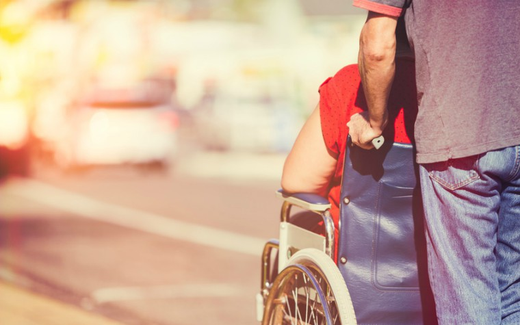 description_of_image_used_in_domestic_abuse_and_disability_quick_guide_man_pushing_woman_in_wheelchair_Jason_Stitt_Fotolia_760x475