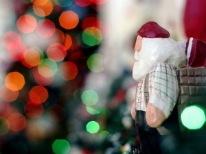A santa toy and christmas tree