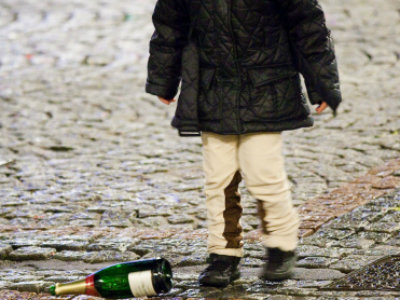 child kicking bottle
