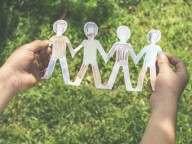 child holding family paper cut out