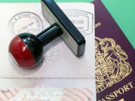 uk passport with stamped visa