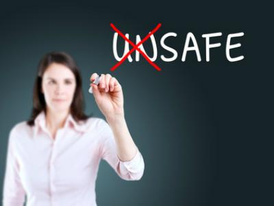 Woman writing 'safe'