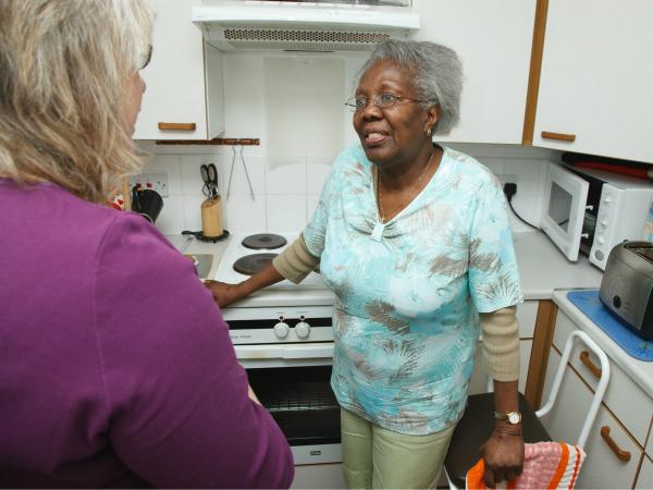 Social worker talking to carer