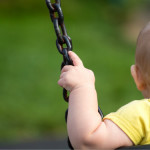 Baby_on_swing_posed_by_model