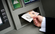 Description_of_image_used_in_mate_crime_top_tips_article_withdrawing_money_from_cashpoint_REX_Shutterstock