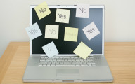 Description_of_image_used_in_supported_decision_making_article_laptop_with_postits_saying_yes_no_and_maybe_ImageSource_REX_Shutterstock