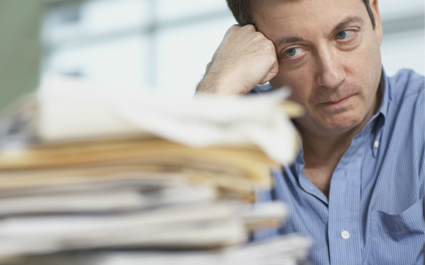 Social worker looking at paperwork and feeling stress