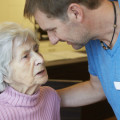 Description_of_image_used_in_homecare_dementia_piece_care_worker_with_older_woman_WestEnd61_REX_Shutterstock
