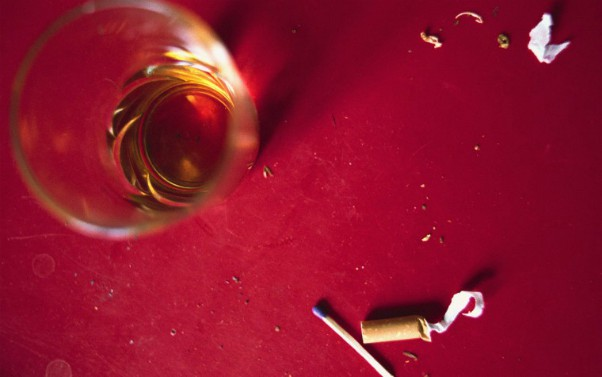 Description_of_image_used_in_parental_substance_misuse_research_review_whiskey_and_cigarette_PhotoAlto_rex_shutterstock