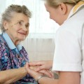 description_of_image_used_in_continuing_healthcare_tips_piece_older_woman_with_nurse_Alexander_Raths_Fotolia