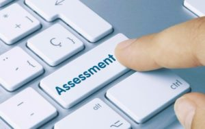 Image of computer key marked 'assessment' (Credit: momius / Adobe Stock)