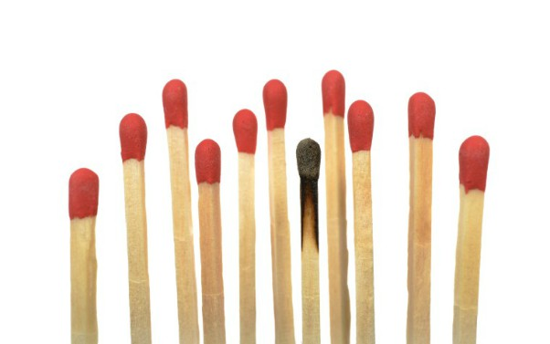 description_of_image_used_in_burnout_podcast_row_of_matches_with_one_burnt_out_imagebroker_rex_shutterstock