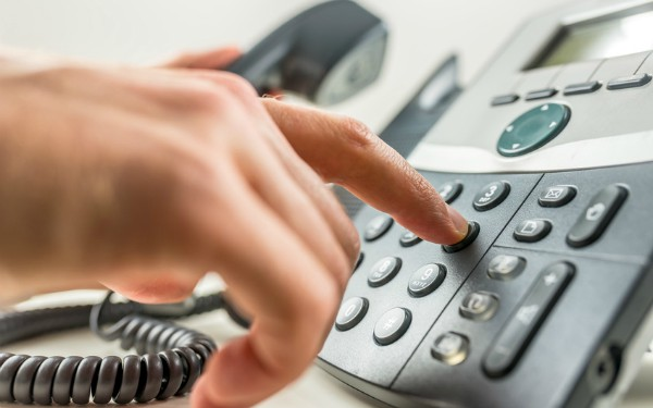 description_of_image_used_in_social_work_diary_hand_dialling_a_phone_Fotolia_Gajus_600x375