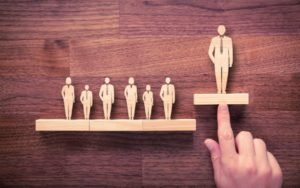description_of_image_used_in_practitioner_manager_piece_person_standing_above_others_fotolia_Jakub_Jirsák