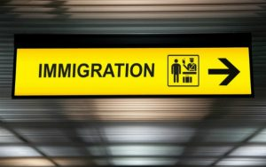 A sign saying 'immigration' at an airport