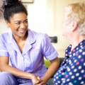 Care worker speaking to older person