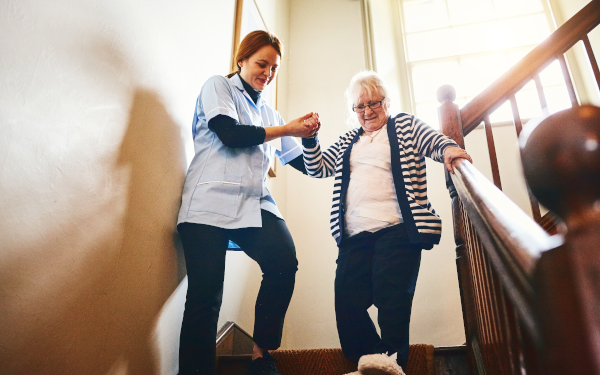 Care worker helping older person with mobility