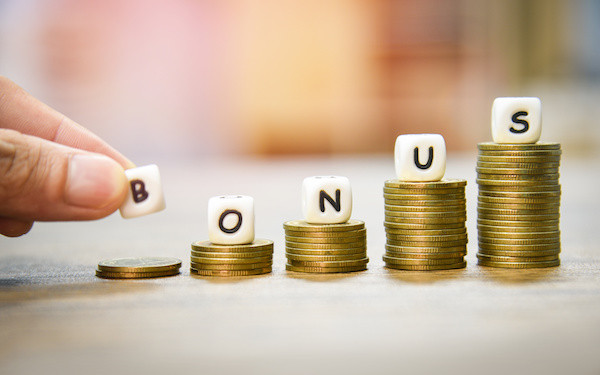 Image of the word 'bonus' on top of stacked coins