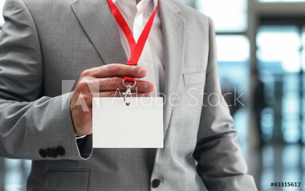 man holding blank name tag