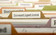 Image of filing cabinet with 'investigations' label