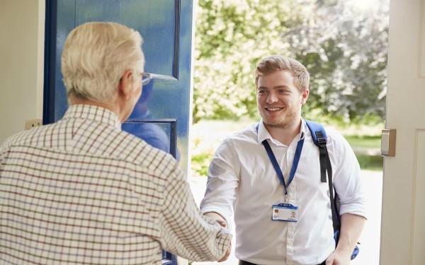 Male social worker on home visit to older man