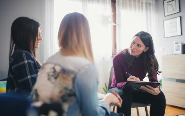 Social worker on home visit