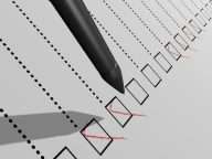 Image of a pen completing a checklist (credit: JNT Visual / Adobe Stock)