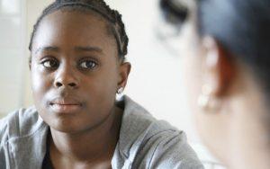 black girl talking to adult woman