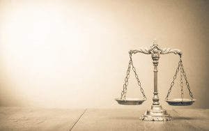 Image of scales of justice (credit: BrAt82 / Adobe Stock)
