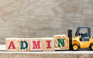 Image of forklift shifting barriers labelled 'admin' (Credit: bankrx / Adobe Stock)