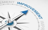 Image of compass arrow pointing to word 'improvement' (credit: Coloures-Pic / Adobe Stock)