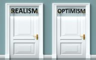 Image of two doors marked 'realism' and 'optimism' (credit: GoodIdeas / Adobe Stock)