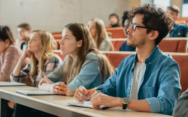 Image of students in lecture theatre (credit: Gorodenkoff / Adobe Stock)